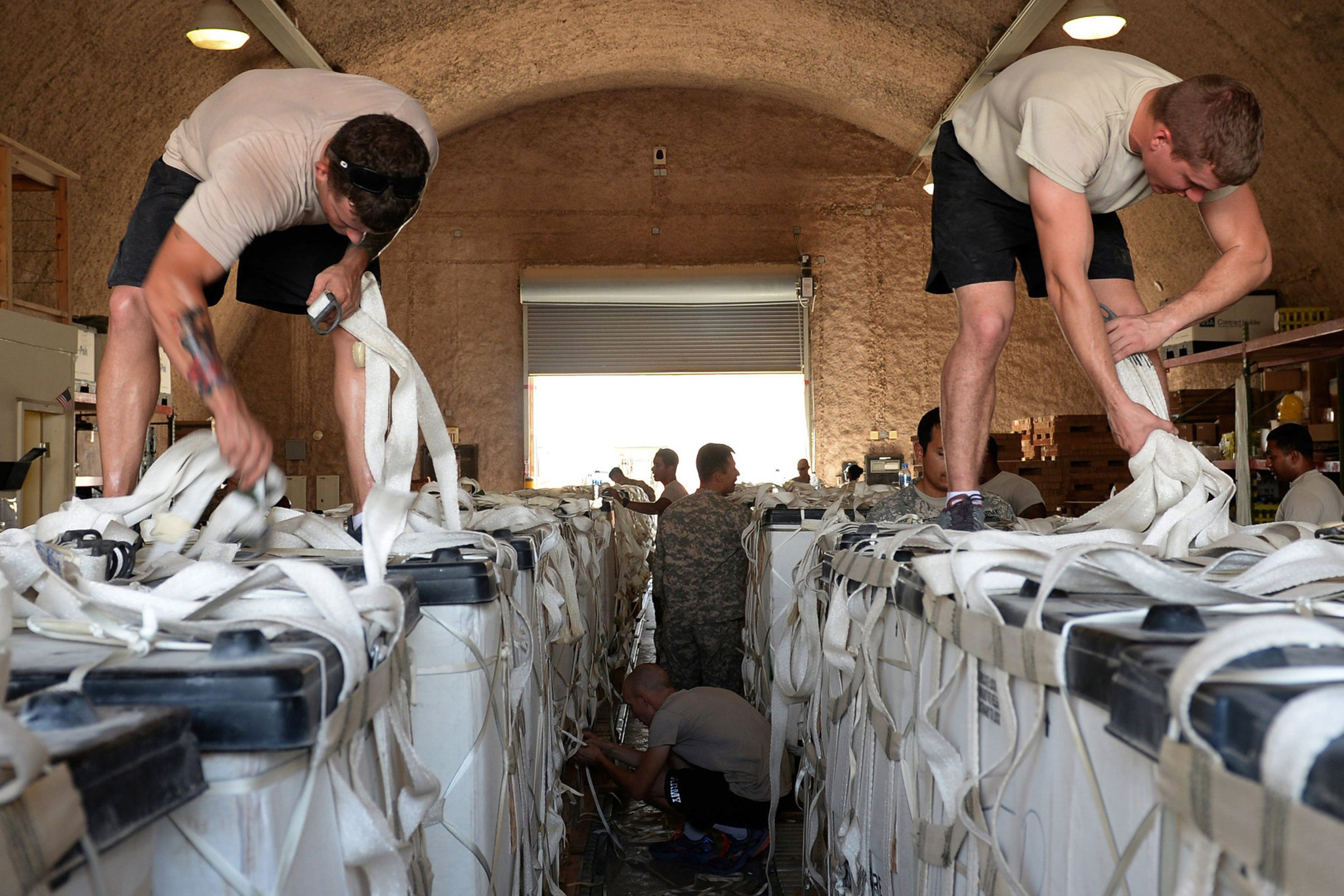 Parachute riggers for the United States Army prepared water to be airdropped over Iraq.