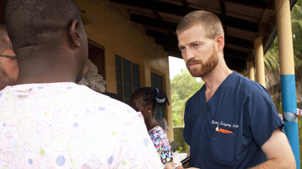 Dr. Kent Brantly (R) speaks with colleagues at the case management center on the campus of ELWA Hospital in Monrovia, Liberia in this undated handout photograph courtesy of Samaritan's Purse.