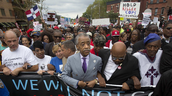 "Reverend Al Sharpton ( C) takes part in the ""We Will Not Go Back"" march and rally for Eric Garner in the Staten Island borough of New York August 23, 2014."