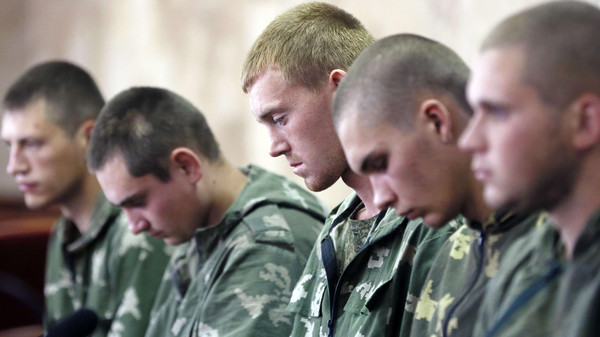 Russian paratroopers captured by Ukrainian forces near the village of Dzerkalne, Donetsk region, some 20 to 30 kilometres from the Russian border.