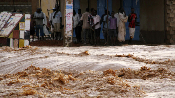 Residents watch churning flood waters in Salhaa, Omdurman July 30, 2014.