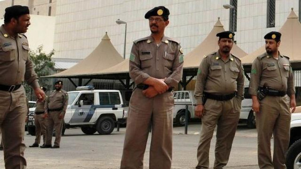 Saudi policemen stand guard in front of a governmental building in Riyadh.
