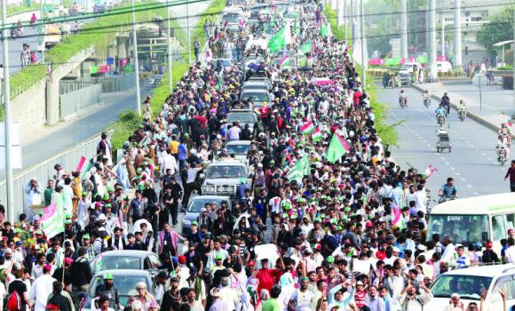 Supporters of Tahir ul Qadri attend a protest march to Islamabad, in Lahore on Thursday.