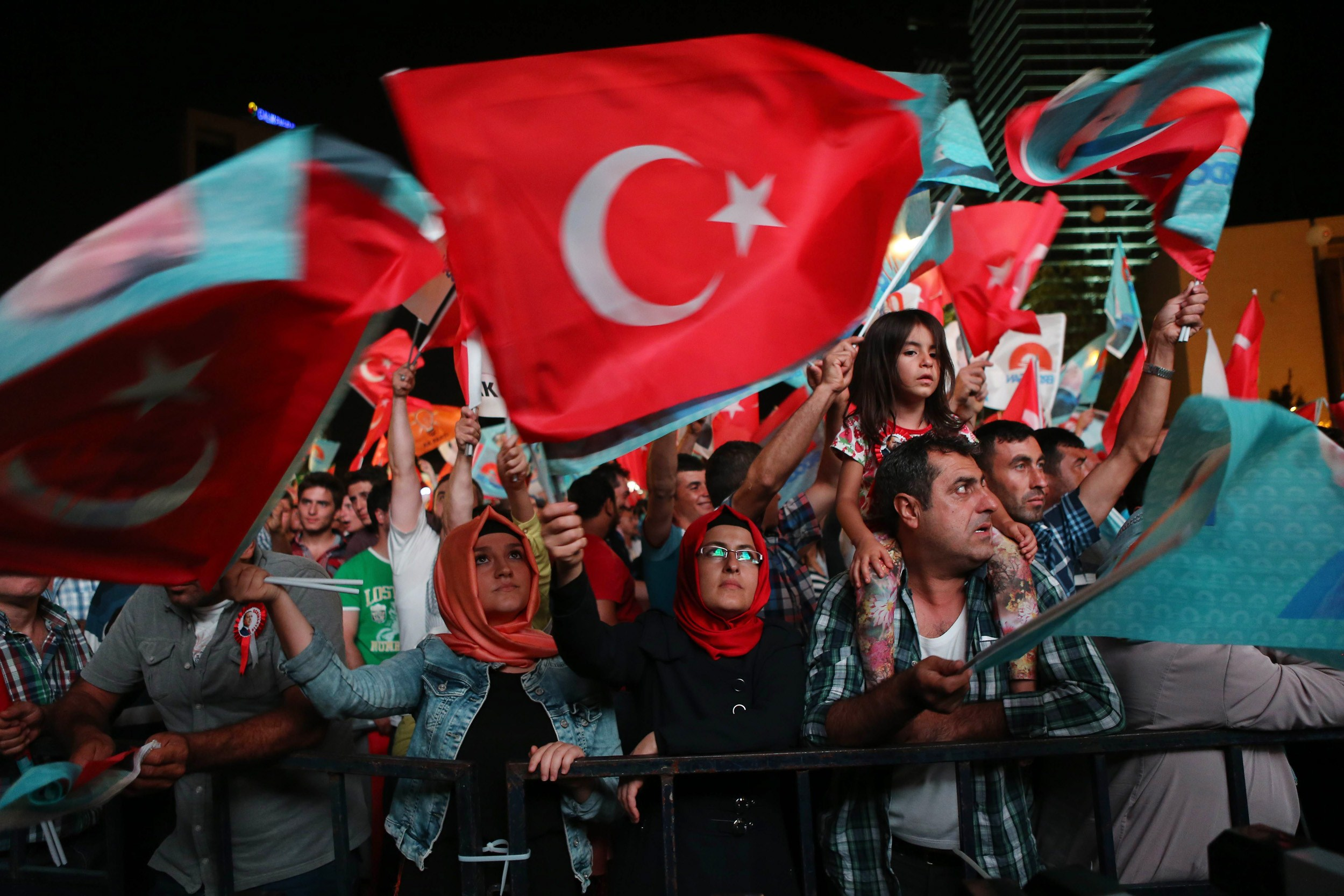 Supporters of Turkey's Prime Minister Recep Tayyip Erdogan celebrate his victory in the presidential election vote in front of the AKP party headquarters in Ankara on August 10, 2014.