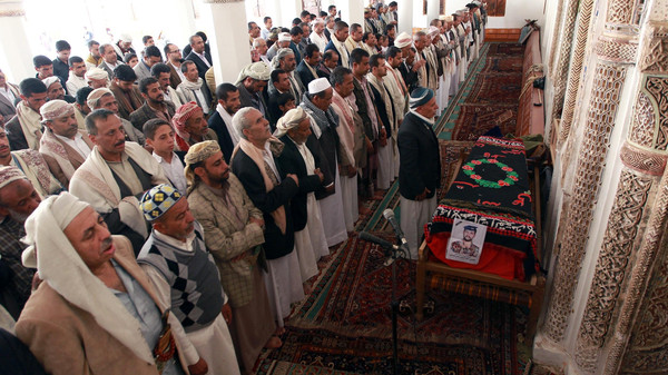 Yemeni mourners pray during the funeral of a soldier, who was killed by al-Qaeda militants in the southeastern province of Hadramawt.