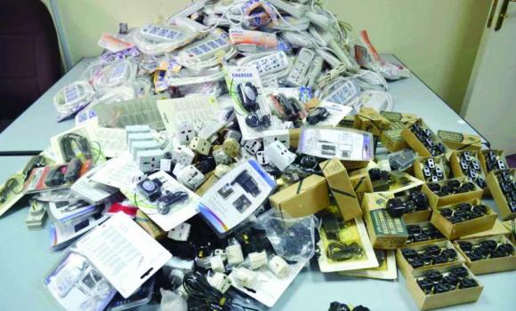 A pile of counterfeit electrical sockets and appliances seized during raids by inspectors of the Ministry of Commerce and Industry in Taif. (SPA)