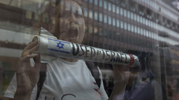 A demonstrator protests in the Department for Business Innovation and Skills building in London July 23, 2014.