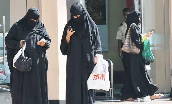 In this Nov. 7, 2013 file photo, Saudi women leave a shopping mall.