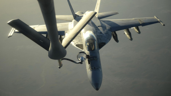 A U.S. Navy F-18E Super Hornet receives fuel from a KC-135 Stratotanker over northern Iraq after conducting air strikes in Syria on September 23, 2014.