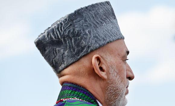 Afghan President Hamid Karzai arrives for an inauguration ceremony at Wazir Akbar Khan hill in Kabul, in this September 10, 2014 photo.