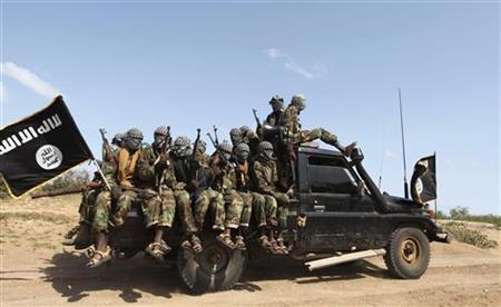 Members of al Shabaab, al Qaeda-linked insurgents, ride in a pick-up truck after distributing relief to famine-stricken internally displaced people outside Somalia's capital Mogadishu, September 3, 2011.