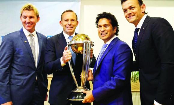 Australian PM Tony Abbott, second left, holds the ICC world cup with India's retired batting maestro Sachin Tendulkar as they pose with Australian cricketers Brett Lee and Adam Gilchrist in Mumbai on Thursday.