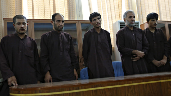 Five of seven men convicted of raping and robbing appear at a court in Kabul September 7, 2014.