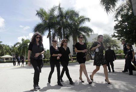 Cousins of slain U.S. journalist Steven Sotloff leave Temple Beth Am, where a memorial service was held.