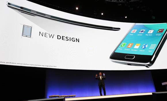 DJ Lee, executive vice president of Samsung, presents a Samsung Galaxy Note Edge during his keynote speech at an unpacked event of Samsung ahead of the consumer electronic fair IFA in Berlin, Wednesday, on Wednesday.