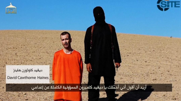 A still image taken from a purported ISIS video released September 13, 2014 of British captive David Haines before he is beheaded.