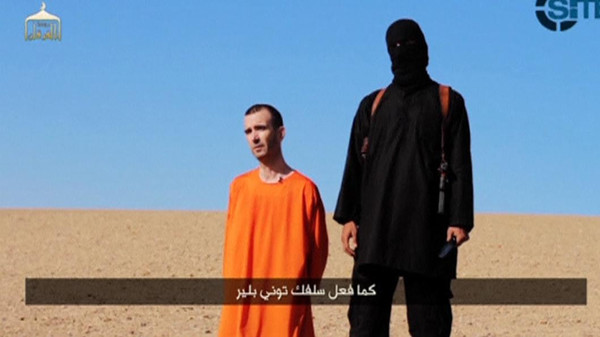 A still image taken from a purported Islamic State video released September 13, 2014 of British captive David Haines before he is beheaded.