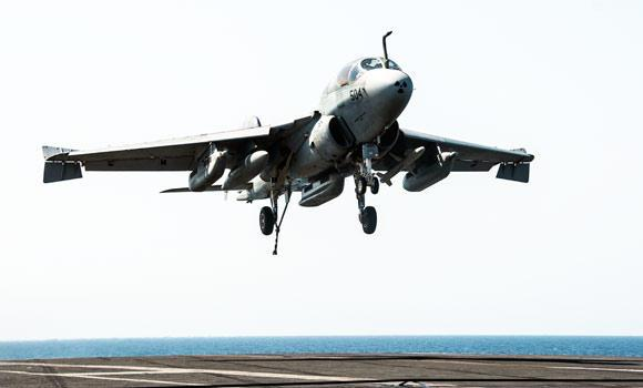 In this photo provided by the U.S. Navy a EA-6B Prowler attached to the Garudas of Electronic Attack Squadron (VAQ) 134 lands aboard the aircraft carrier USS George H.W. Bush after conducting strike missions on Tuesday, against Islamic State group targets in Syria.