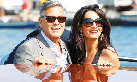 George Clooney and Amal Alamuddin arrive in Venice, Italy, on Friday.