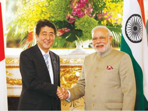 India's Prime Minister Narendra Modi, right, and Japan's Prime Minister Shinzo Abe shake hands before their talks at the state guest house in Tokyo on Monday.