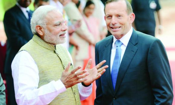 Indian Prime Minister Narendra Modi, left, speaks with Australian Prime Minister Tony Abbott during a welcoming ceremony at the presidential palace in New Delhi on Friday.