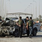 Suicide bombing, shelling kill 14 in Baghdad
