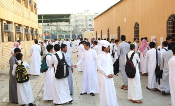 Students greet one another on the first day of the new academic session in Jeddah on Sunday.