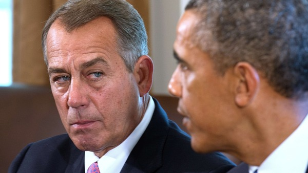 Speaker of the House John Boehner (L), R-OH, listens as US President Barack Obama delivers a statement on Syria during a meeting with members of Congress at the White House in Washington, DC, Sep. 3, 2013.