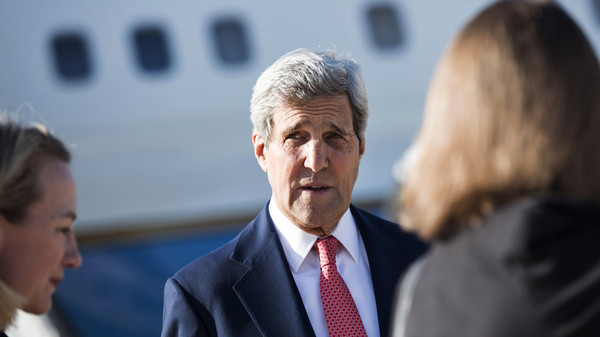 U.S. Secretary of State John Kerry arrives at Queen Alia Airport in Amman before making his way to Baghdad on September 10, 2014.