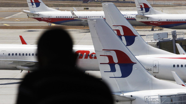 Malaysia Airlines planes sit on the tarmac at Kuala Lumpur International Airport.