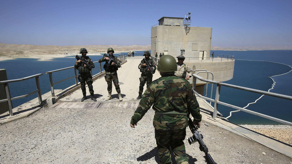 Peshmerga fighters stand guard at Mosul Dam in northern Iraq after retaking the dam from ISIS militants, August 21, 2014.
