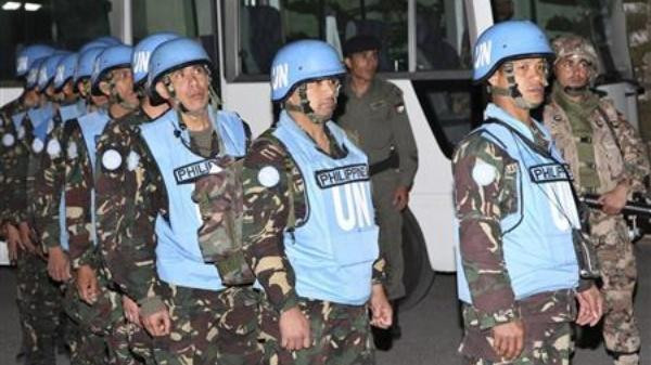 The Philippines pulled its peacekeepers from the Golan Heights ahead of schedule amid worsening security there.