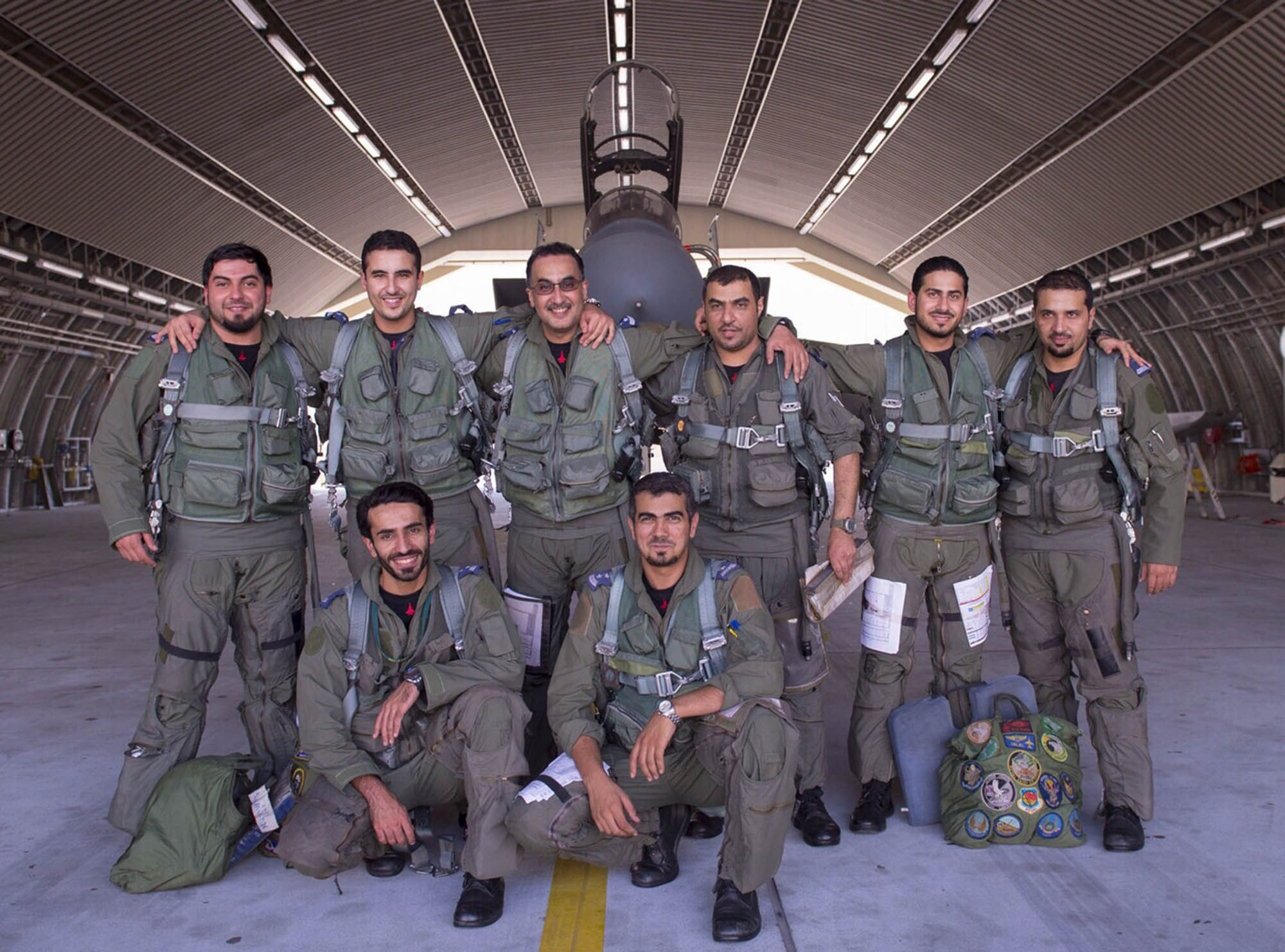 In a handout picture released by the official Saudi Press Agency (SPA), Saudi Arabian air force pilots pose for a photo at an undisclosed location after taking part in a mission to strike Islamic State (IS) group targets in Syria on September 23, 2014.