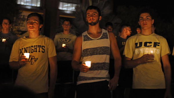 Students hold candles during a vigil honoring U.S. journalist Steven Sotloff  at the Reflection Pool on the campus of the University of Central Florida in Orlando, Florida, September 3, 2014.  Sotloff, a former student at the university, was the second American journalist beheaded by Islamic State militants, within weeks, in retaliation to U.S. airstrikes in Iraq.