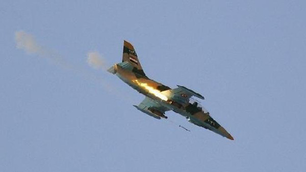 A Syrian Air Force fighter plane fires a rocket during an air strike in the village of Tel Rifaat, about 20 miles north of Aleppo, on August 9, 2012.