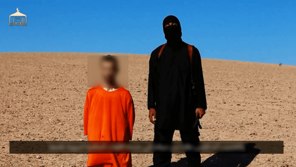 The masked man, who was dubbed by UK media as 'Jihadi John,' seen in a still from the video where the group beheaded U.K. aid worker David Haines