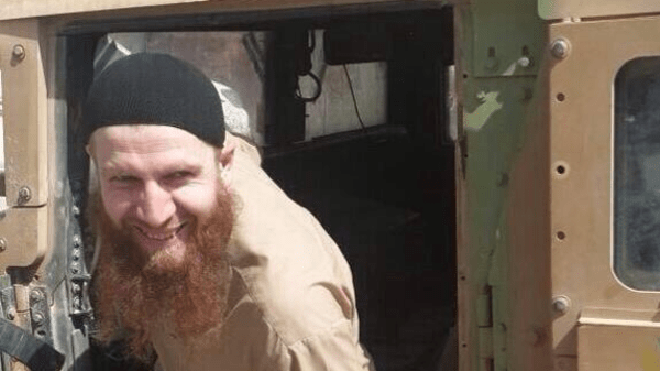 ISIS commander Umar al-Shishani is pictured exiting a US-supplied Humvee stolen from Mosul, Iraq, and transported back to Syria.