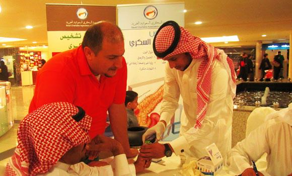 Visitors gather at the diabetes awareness campaign center, in Riyadh, for free glucose test.