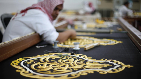 Workers embroider the Kiswa, a silk cloth covering the Holy Kaaba, in the holy city of Mecca, ahead of the annual haj pilgrimage October 8, 2013.