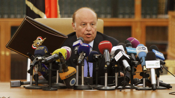 Yemen's President Abd-Rabbu Mansour Hadi speaks as he holds up an agreement signed between the government and Houthi rebels, in Sanaa September 21, 2014.