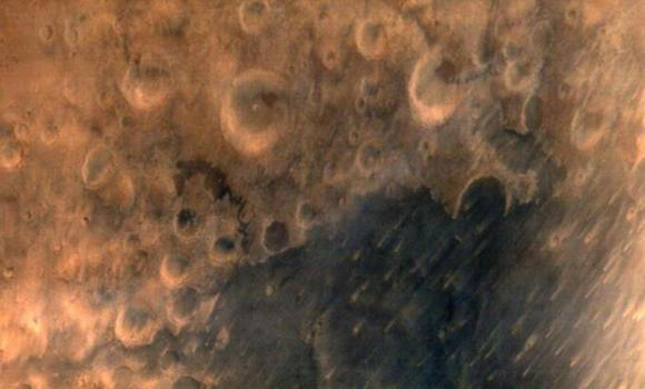 In this handout photograph released by the Indian Space Research Organization (ISRO) on Thursday, the surface of Mars is seen from a height of 7,300 meters in the first image taken by the ISRO Mars Orbiter Mission (MOM) spacecraft.