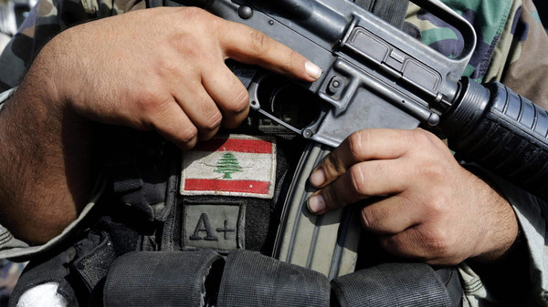 A Lebanese army soldier holds his weapon after being deployed to tighten security, following clashes between Lebanese soldiers and Islamist gunmen in Tripoli, northern Lebanon October 27, 2014.