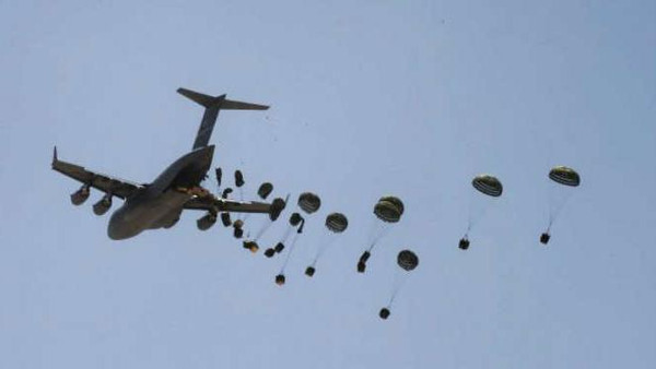 A US Airforce C-17 plane drops food and water at Camp Dwyer in the Helmand Province in Afghanistan. NATO-led forces are seizing the initiative against Taliban insurgents in southern Afghanistan as thousands of US reinforcements move into the area.