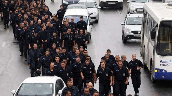 Algerian policemen take part in a public protest near the Presidential Palace in Algiers on Oct. 15, 2014.