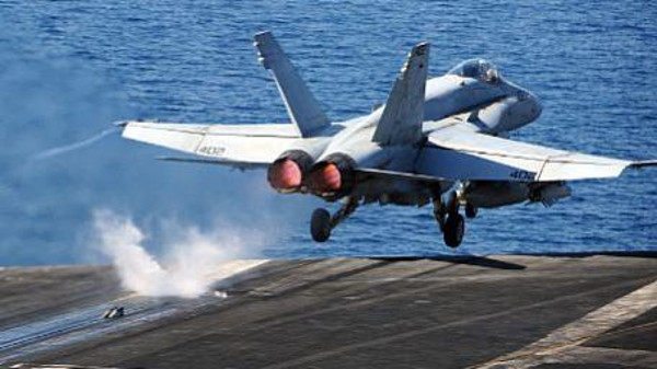 An F/A-18C Hornet assigned to the Golden Warriors of Strike Fighter Squadron (VFA) 87 takes off from the flight deck of the aircraft carrier USS George H.W. Bush (CVN 77) strike operations in Iraq and Syria.