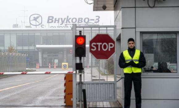 An airport security guard at the entrance of the Vnukovo-3 Business Aviation Center at Moscow's Vnukovo airport.