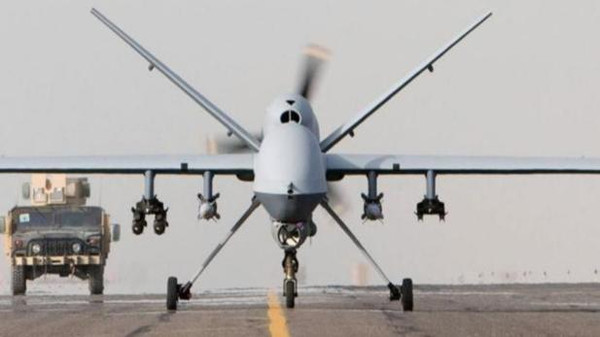 An armed unmanned Reaper drone prepares for takeoff