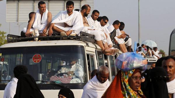 Muslim pilgrims sit on top of a bus as they leave the plains of Arafat during the annual hajj pilgrimage, outside the holy city of Mecca October 3, 2014.