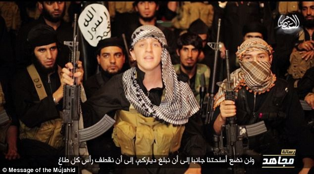 Australian boy Abu Khaled, believed to be Abdullah Elmir, speaks flanked by other ISIS jihadists in a recent ISIS propaganda video.