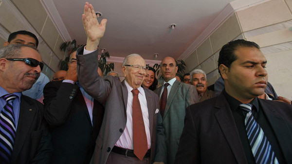 Beji Caid Essebsi, Nidaa Tounes party leader, waves outside Nidaa Tounes headquarters in Tunis Oct. 28, 2014.